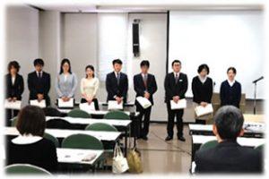 生協大会で表彰された7名と講演の様子